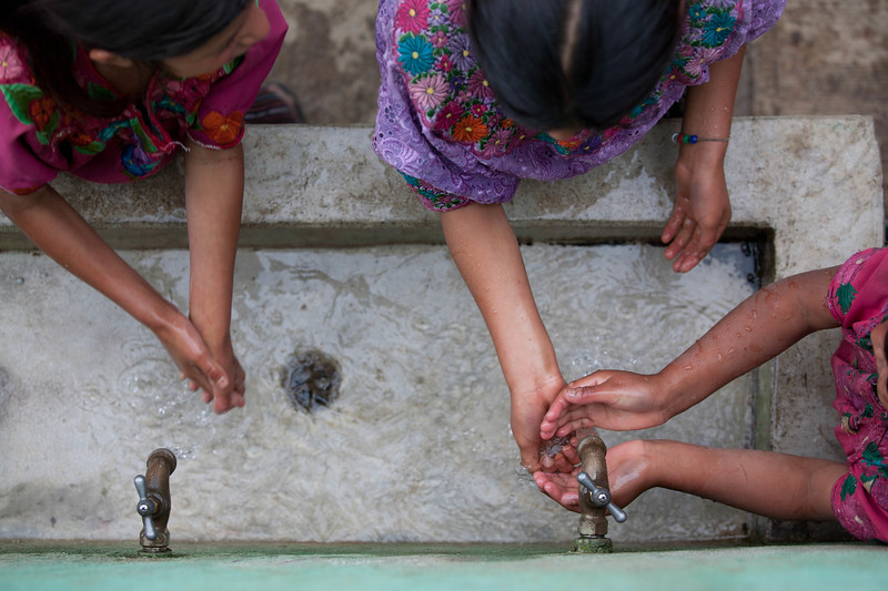 A group of girls wash their hands at their school in Guatemala. Teaching good hygiene habits at a young age keeps kids healthy and in school!