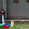 A woman washing clothes in Uganda. Women are often the ones travelling long distances to fetch water as they need to use it for household chores such as cleaning, washing clothes, and cooking.