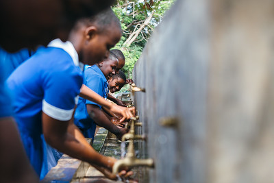 Students wash their hands at a school in Blantyre, Malawi.