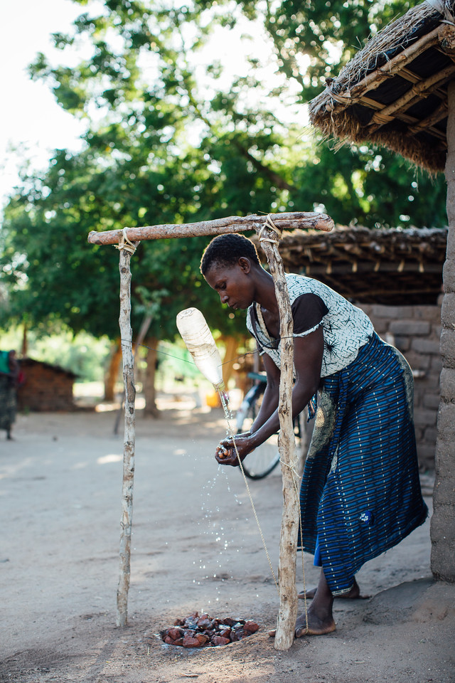 A woman washes her hands in Malawi. Handwashing can reduce diarrhea cases by 50%. This simple solution improves the health of entire communities and can saves lives.  This is why we educated over 220,000 people about hygiene in 2017.