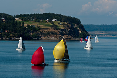 Racing Past Blower's Bluff: Penn Cove, Washington.