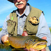 Ken Dunston with a Big Meadow brown.<br /> Photo: Jamie Anderson