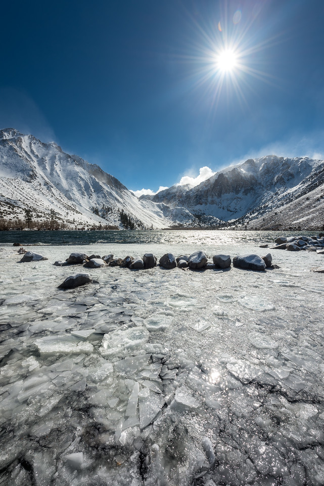Sunburst at a frozen Convict Lake in the winter