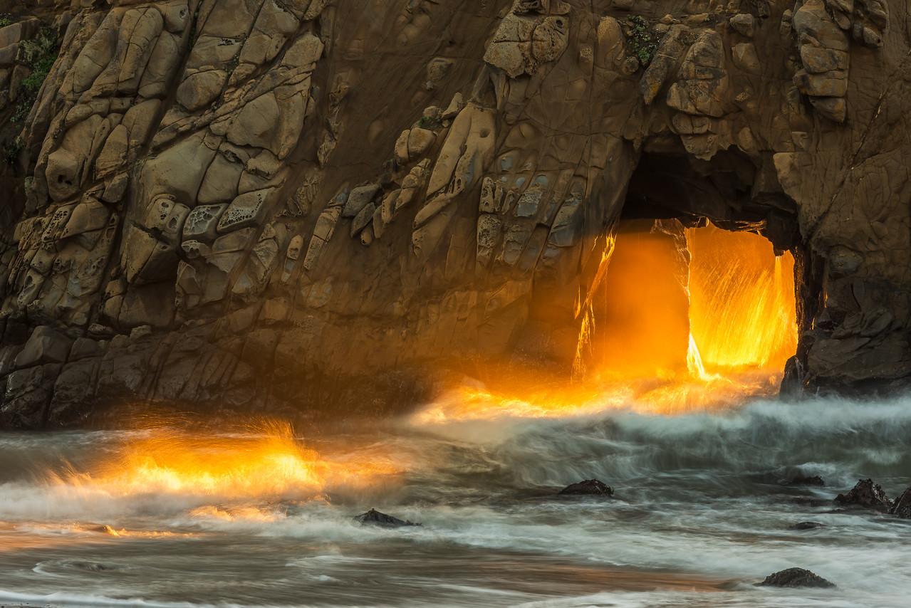 Big Sur keyhole sunset beam