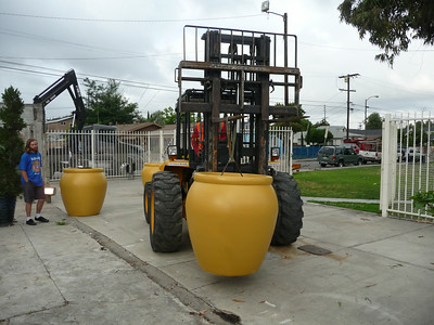 Once the planters and benches are in the entry, they are moved into place via forklift.