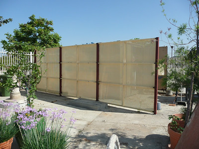The perforated steel screen does a good job of obscuring the storage container/eyesore.