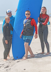[L-R]: Nicole Burney, from PA, Josh Harper, from San Clemente CA, Luke Michetti, from Staten Island, and Alaina Pobok, from Jackson. Waves of Impact day 1 in Lavallette, NJ on 8/1/19. [DANIELLA HEMINGHAUS]