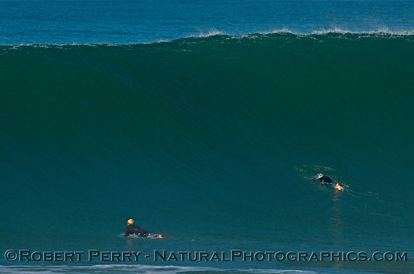 Two surfers paddle out as Hurricane Marie storm surf pounds Zuma Beach - Malibu
