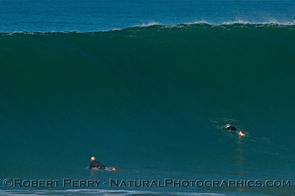 Two surfers paddle out as Hurricane Marie storm surf pounds Zuma Beach - Malibu