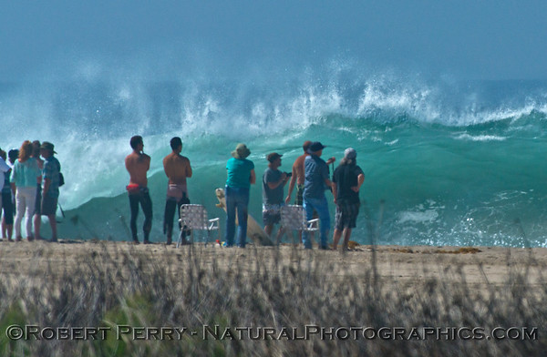A big wave fan club congregates as Hurricane Marie storm surf pounds Zuma Beach - Malibu