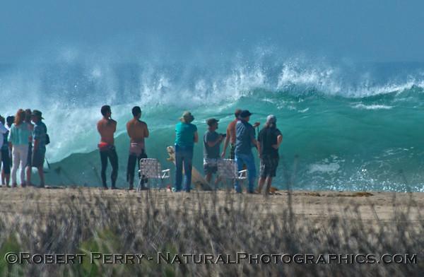 A big wave fan club congregates as Hurricane Marie storm surf pounds Zuma Beach - Malibu