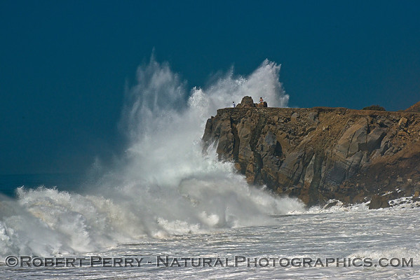 When you click and enlarge this image, you will see two people on top of the sea cliff as Hurricane Marie storm surf pounds Point Mugu - east side of the rock