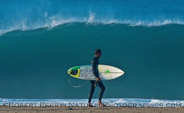 Surfer and wave - Hurricane Marie storm surf pounds Zuma Beach - Malibu