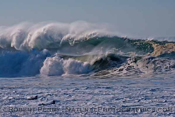 In the lower left corner two surfers paddle out into Hurricane Marie storm surf at Point Mugu - west side