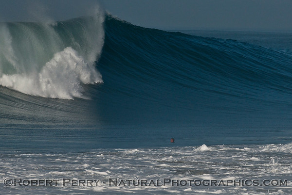 Hurricane Marie storm surf pounds Point Mugu - west side of the rock - note the person's head inside the surfline