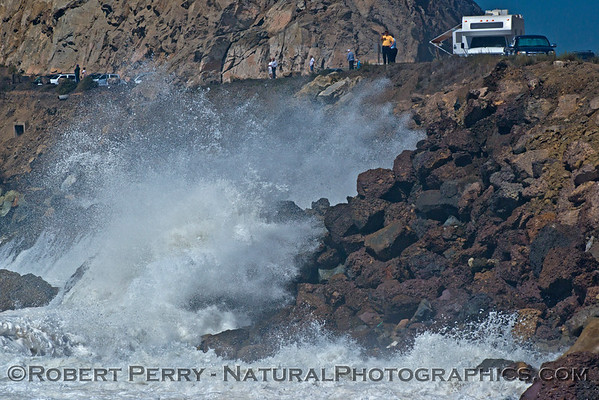 Waves crash against the rocks an send spray flying on to the Pacific Coast Highway - Point Mugu Rock - east side