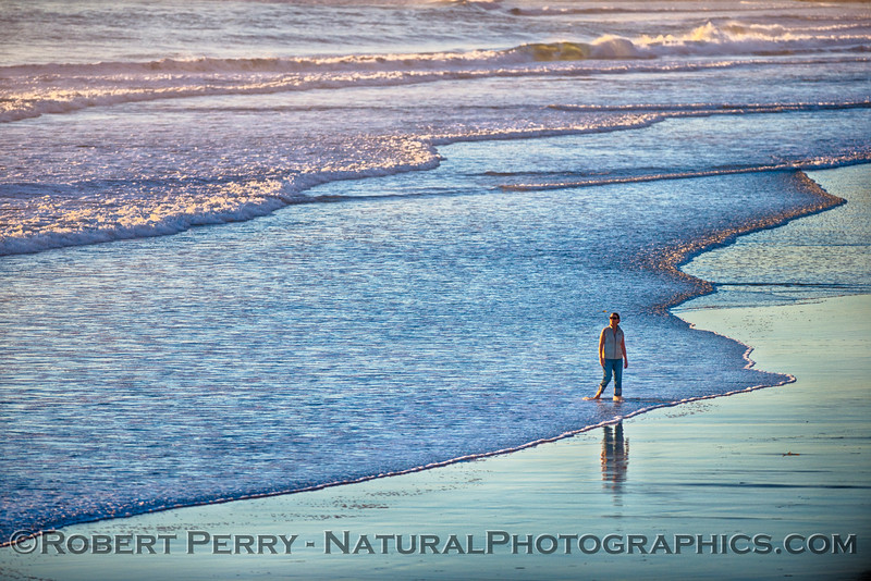 Walking on water 2 of 3 - Woman on wet sand.
