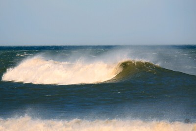A huge swell gets beat down by the wind