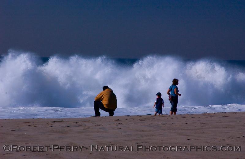 QQQ-Man squats child woman whitewater Big Waves surf 2007 12-05 Zuma - 1219mod