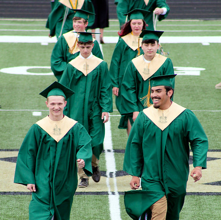 Roger Schneider   The Goshen News<br /> <br /> Wawasee High School seniors walk across the stadiuim field on their way to received their diplomas Sunday.