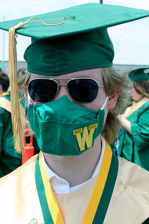 Roger Schneider | The Goshen News<br /> Befitting the senior class's struggle with the COVD-19 pandemic, Keegan Cook donned his facemask before the Wawasee High School graduation Sunday.