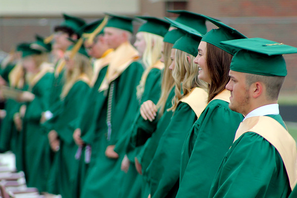 Roger Schneider   The Goshen News<br /> Smiles were everywhere Sunday at the Wawasee High School graduation ceremony. Here, Bronwyn Bonner shows her's. Bronner led the student prayer during the ceremony.