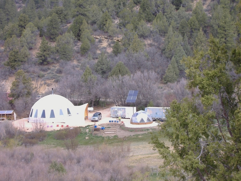 A sweet geodesic dome compound north of Glendale, UT along highway 89...eight solar panels, greenhouse, multi-tiered box garden and large Shepherd dog.