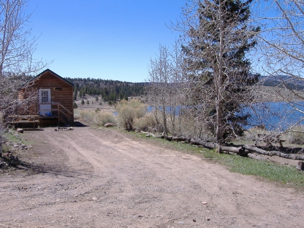 Our parking site. The cabin at the end of the site is for employee housing. To the right (west) is the lake.
