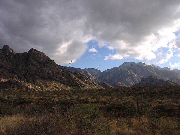 Pusch Ridge wilderness with winter clouds viewed from Sutherland Trail.