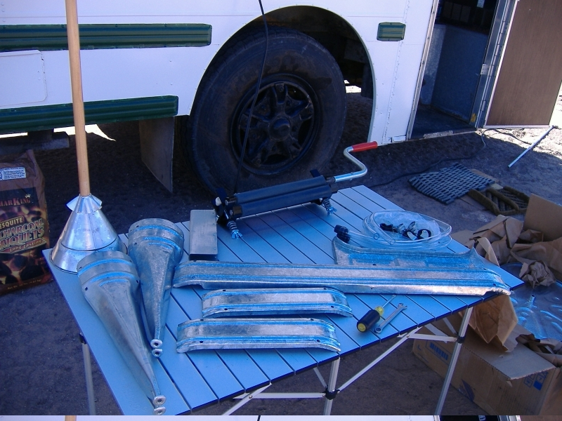 """All of the other bits:<br /> Upper left: Agitating tool<br /> Lower left: washtub stand legs<br /> Upper right: Hand-wringer<br /> Center: Washtub stand sides<br /> Also included are 2 lengths of clear drain hose, casters, and all of the necessary nuts and bolts.<br /> Only tools needed are a flathead screwdriver and 7/16"""" wrench."""