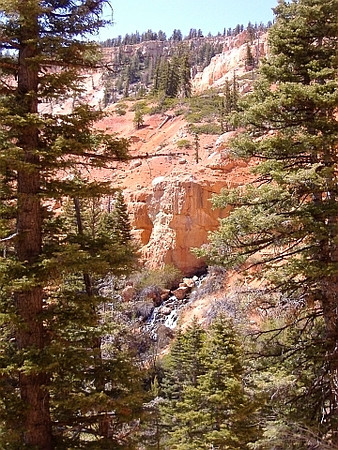 Cascade Falls, which emanates from a lava tube in the cliffs beneath Navajo Lake. May.