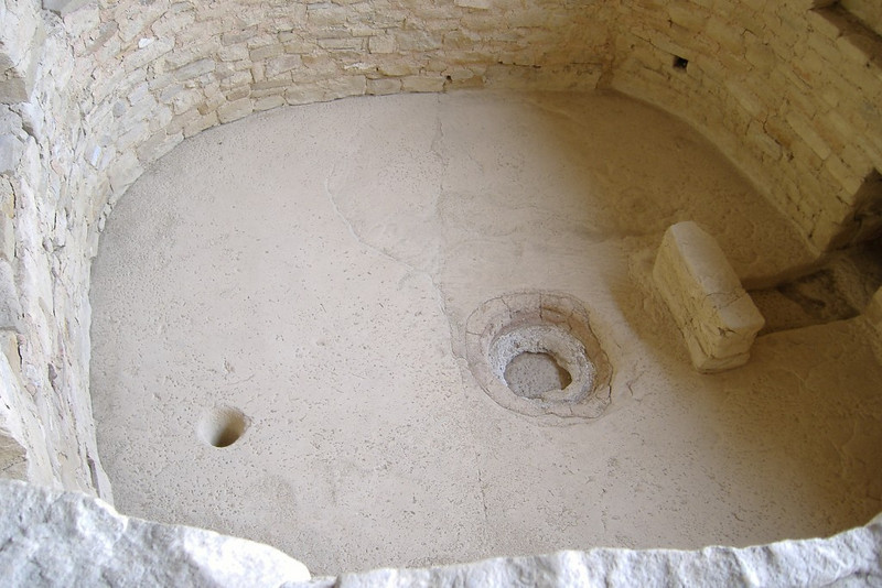 Kiva floor at Balcony House. At left is a <i>sipapu</i>, which represents the portal through which ancient Puebloan ancestors entered the world. Right of that is a fire pit, and right of that, a windbreak.