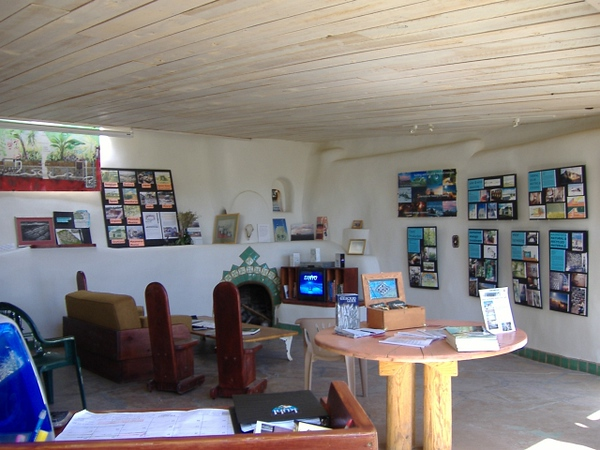 The main living area of the example earthship. Many features of the earthship building concept are displayed.