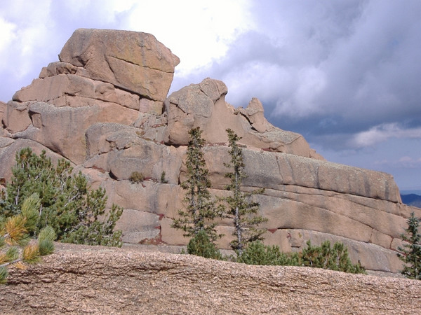 Massive granite formation. For a sense of scale note the full grown evergreens at the base.