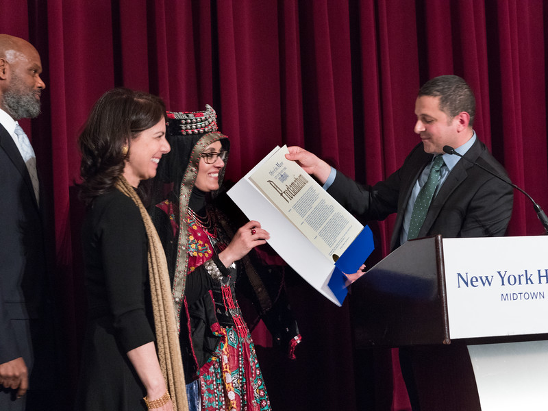 Deliverd by an aide, Mayor DiBlsio issued a proclamation thanking the Muslim Community Netowrk for their important civil rights work and for building unity and tolerance among New York's varied  ethnic communities.