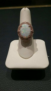 14kt, 4.66cttw Opal surrounded by .72 cttw diamonds!