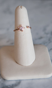 6: 14kt rose gold star ring with .08 diamond weight. #196-00296