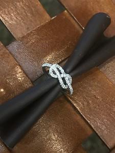 .39cttw, 14k white gold love knot.