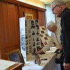 Viewing photos and other mementos from Fr. Charlie's life