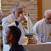 Concelebrants receive communion