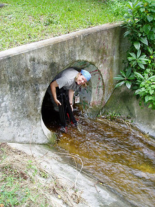 © Jill Heinerth, IntoThePlanet.com Jill heinerth emerges from a storm sewer after an urban caving to follow the path of water through the landscape. Photo: Scott Braunsroth