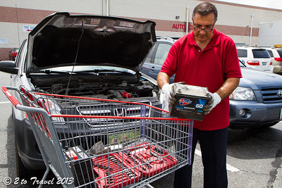 Out with the old battery. Costco Parking Lot, Glen Allen, VA - 10 Jun 2013