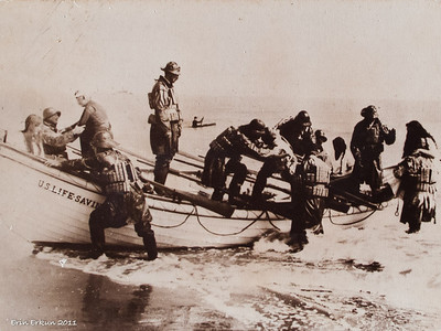 The surfboat landing with shipwreck survivors on board; note the cork life jackets worn by the men. (From the exhibit in the small boathouse.)
