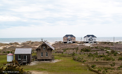 The 1874 station with the 1892 cook house to the left, and the wreck pole, beach houses, and the Atlantic Ocean in the distance … from the watch tower.