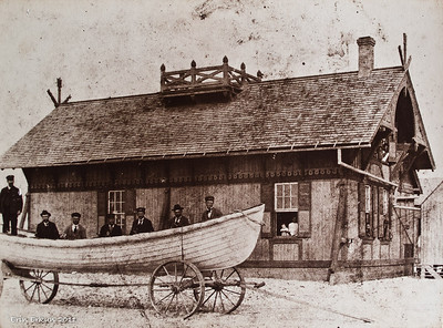 Typical NC 1874 life-saving station with the keeper (far left).  Note the visitors that can been in every window.  Back in the time, these life-saving stations were also community centers for the isolated villages of the Outer Banks.  (From the exhibit in the small boathouse.)
