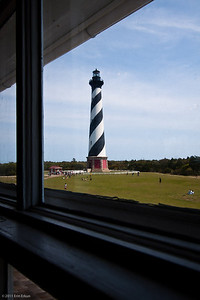Cape Hatteras Lighthouse - Cape Hatteras National Seashore Glimpse of the lighthouse from inside the keeper's house (now a museum).  The lighthouse replaced the original 90-foot beacon built in 1803.  Confederate soldiers removed the light's lens in 1861.  In 1870, more than 1,000,000 bricks were used to build the current lighthouse.