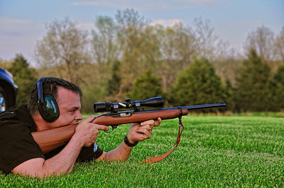 Chris shooting a Ruger 44 magnum rifle.  Note the brass being ejected from the rifle.