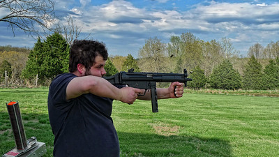 Justin shooting the H&K MP5 on full auto.