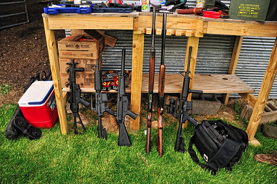 Some of the weapons (from left to right): H&K MP5, AR-15, An MP5 wanna be, two shotguns, and an AR-15.