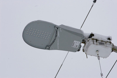 One of the new L.E.D. street lamps covered in icicles.  At 1st Ave NE and NE 195th ST. Photographed: 1-18-2012.